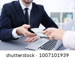 businessman taking bribe from... | Shutterstock . vector #1007101939