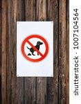 no dog fouling sign.  wooden... | Shutterstock . vector #1007104564