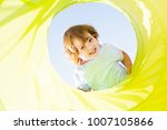 cute happy toddler girl playing ...   Shutterstock . vector #1007105866