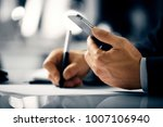 business man with phone | Shutterstock . vector #1007106940
