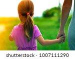 little girl holding a hand of... | Shutterstock . vector #1007111290