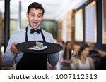 Professional Waiter Holding...