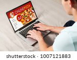man ordering pizza by internet... | Shutterstock . vector #1007121883