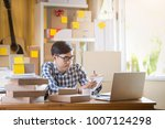 asian man working on laptop at...   Shutterstock . vector #1007124298