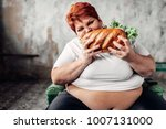 fat woman sits in chair and...   Shutterstock . vector #1007131000