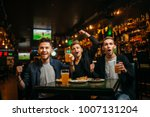 men at the table with beer ...   Shutterstock . vector #1007131204