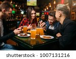 fun friends in a sport bar ... | Shutterstock . vector #1007131216