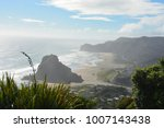 piha beach with rock formations ... | Shutterstock . vector #1007143438