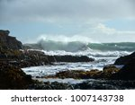 piha beach with rock formations ... | Shutterstock . vector #1007143738