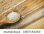 raw rice with wooden spoon on... | Shutterstock . vector #1007156353