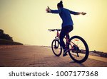 cyclist riding bike with arms... | Shutterstock . vector #1007177368