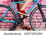 young beautiful girl's legs and ... | Shutterstock . vector #1007191450
