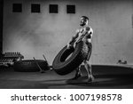 muscular man working out in gym ...   Shutterstock . vector #1007198578