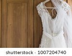wedding dress hanging against a ... | Shutterstock . vector #1007204740