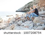 mother and son sitting together ... | Shutterstock . vector #1007208754
