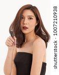 an asian young cute girl pose... | Shutterstock . vector #1007210938