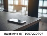 a single mobile phone on wooden ... | Shutterstock . vector #1007220709