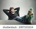 relaxed man sitting with his... | Shutterstock . vector #1007231014
