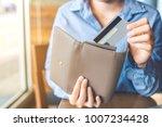 women's hand using a credit...   Shutterstock . vector #1007234428