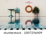 poolside view with single chair ... | Shutterstock . vector #1007256409