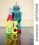 Small photo of wooden letters fact fake on wooden floor and retro robot toy