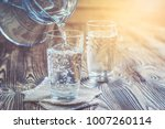 glass of water on a wooden... | Shutterstock . vector #1007260114
