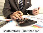 business man using calculator... | Shutterstock . vector #1007264464