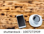 a cup of coffee and a white... | Shutterstock . vector #1007272939