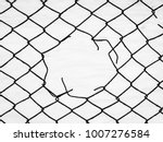 Small photo of Steel mesh fence with torn hall in it.