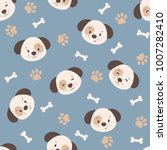 Stock vector vector seamless pattern with cute cartoon puppies bones and dog paws on blue background 1007282410