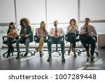 managers sitting on office... | Shutterstock . vector #1007289448
