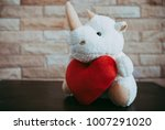 rhinoceros doll holding a red... | Shutterstock . vector #1007291020