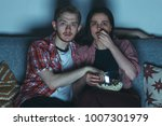 young couple watching thriller... | Shutterstock . vector #1007301979