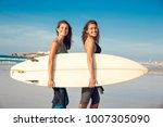 two beautiful female friends at ... | Shutterstock . vector #1007305090