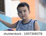 portrait cute boy play outside... | Shutterstock . vector #1007308378