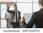 businessman waving to partner...   Shutterstock . vector #1007310793
