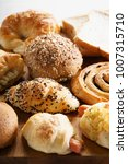 mixed breads and rolls on... | Shutterstock . vector #1007315710