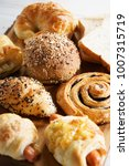 mixed breads and rolls on... | Shutterstock . vector #1007315719