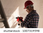 construction worker making hole ... | Shutterstock . vector #1007319598