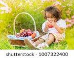little girl eating fruit with...   Shutterstock . vector #1007322400