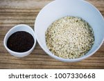 oatmeal in a white cup  wooden... | Shutterstock . vector #1007330668