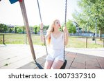 young beautiful woman in a city ... | Shutterstock . vector #1007337310