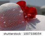 a woman's red hat at the... | Shutterstock . vector #1007338054