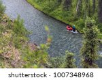 man paddles down the nahanni in ... | Shutterstock . vector #1007348968