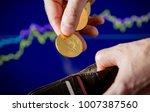 hand putting virtual golden...   Shutterstock . vector #1007387560