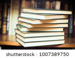 old and used hardback books or... | Shutterstock . vector #1007389750