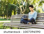 young concentrated woman... | Shutterstock . vector #1007396590