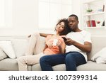 smiling african american couple ... | Shutterstock . vector #1007399314