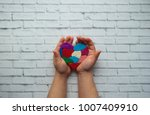 child's hands holding a heart... | Shutterstock . vector #1007409910