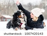 Woman Hugging Her Dog In The...